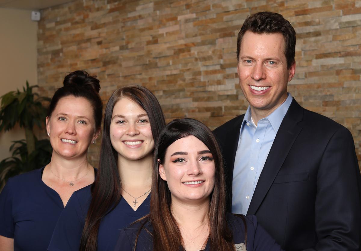 Evergreen CO Chiropractor Dr Jason Steinle with Team